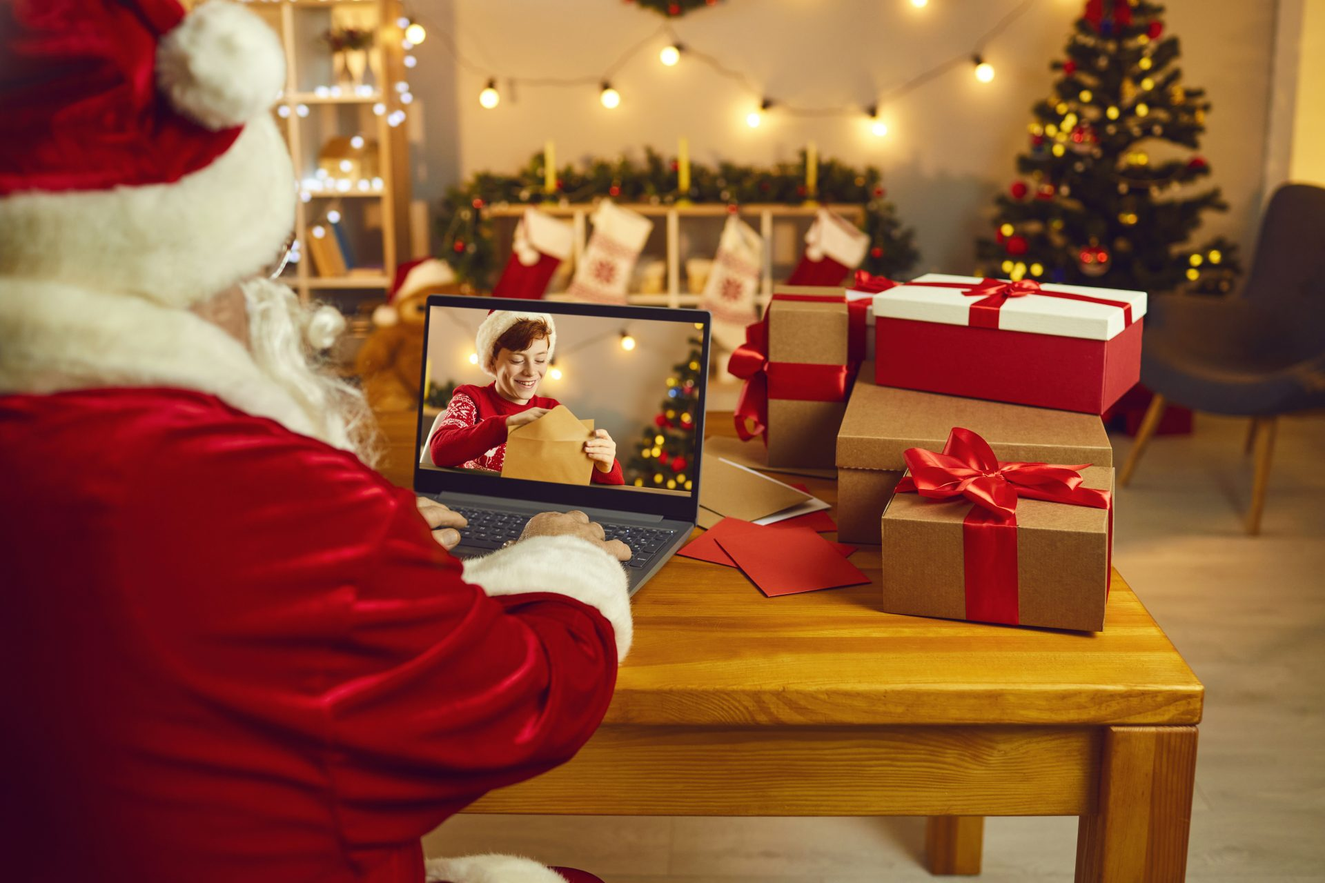 Virtual_Christmas_Staying_Connected_While_We_Are_Apart_During_The_Holidays_Santa_Zoom_Gift_opening